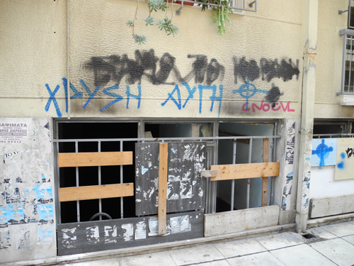 Burned out mosque with golden dawn graffiti Attiki