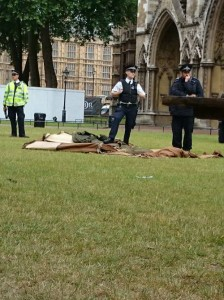 Police standing on tents at Westminster Abbey